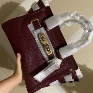 Coach swagger 33  in color burgundy brand new